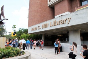Photo of front entrance to John C. Hitt library and the Flame of Hope