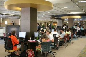 Students focus in the learning commons at Hitt